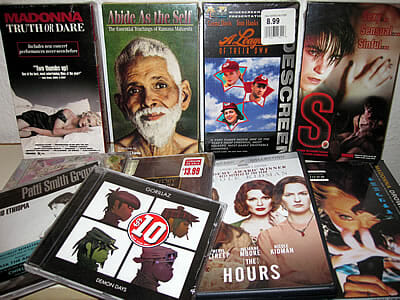 Unopened DVDs, videotapes and CDs