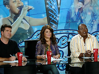 American Idol judges with red plastic Coke cups