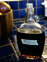 glass bottle of maple syrup with natural cork stopper